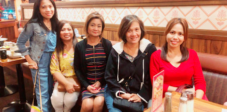 group of ladies smiling in front of a camera