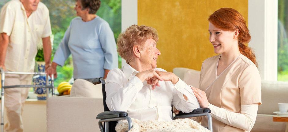 caregiver talking to an elder woman