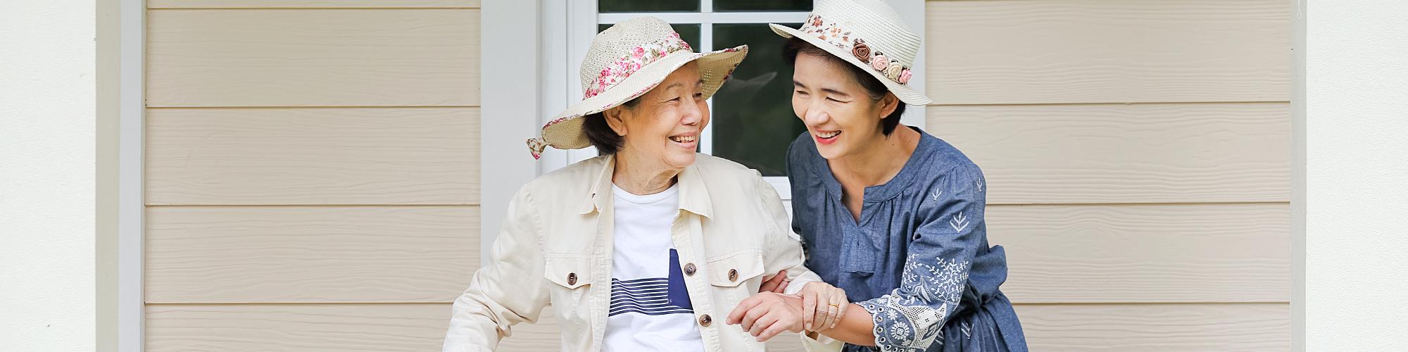 asian lady helping elder woman