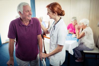 nurse assisting senior